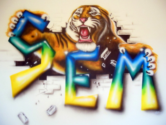 Airbrushmuurschildering van tijger met naam